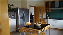 Villa-in-Alcalar-Portimao-Algarve-Portugal---Home41083-Kitchen-with-table-fridge/freezer